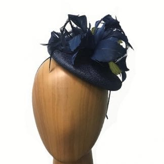 navy with green fascinator