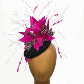 small fuchsia black fascinator.